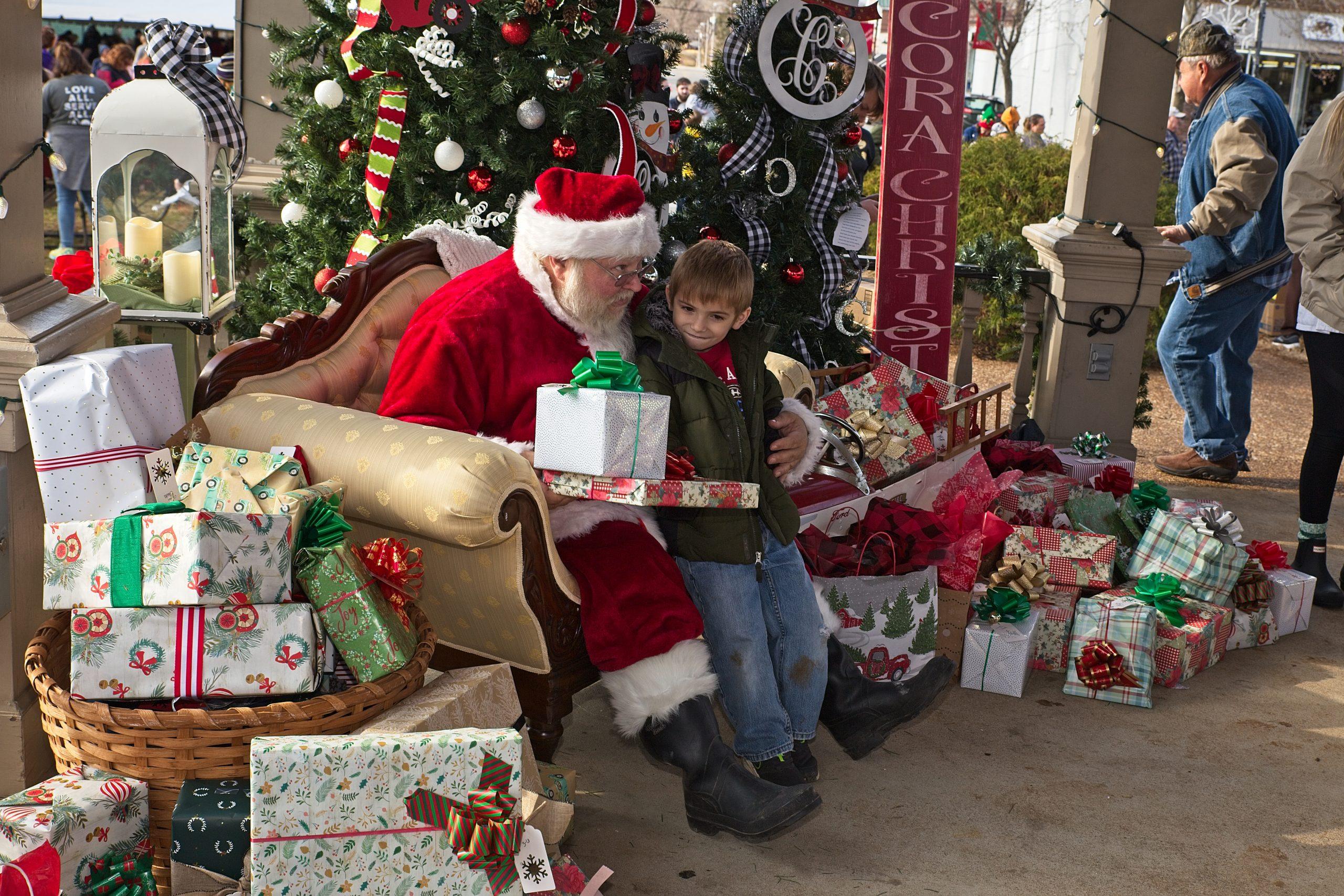 santa giving out gifts at cora's christmas in lawrenceburg tn
