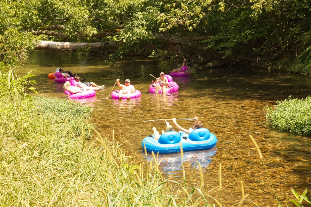 People floating down the creek in a tube from crockett shoals tubing.