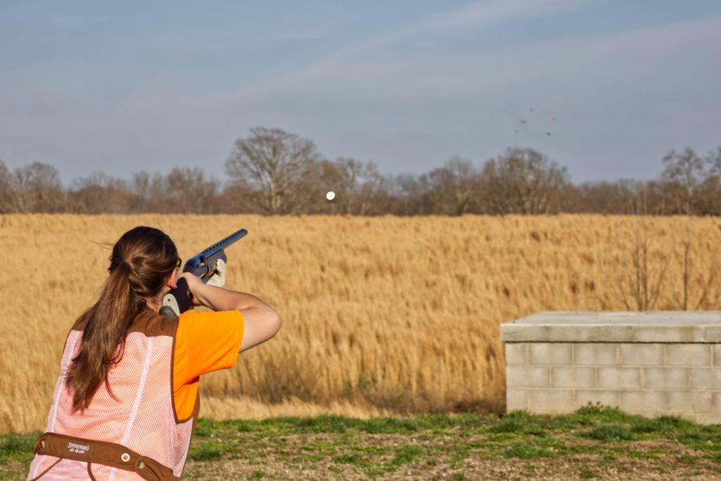 Lady skeet shooter shooting trap.