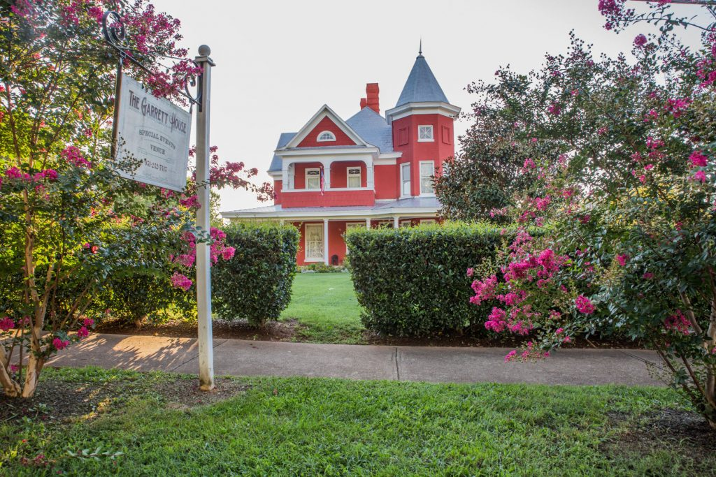 large victorian home called the garrett house.