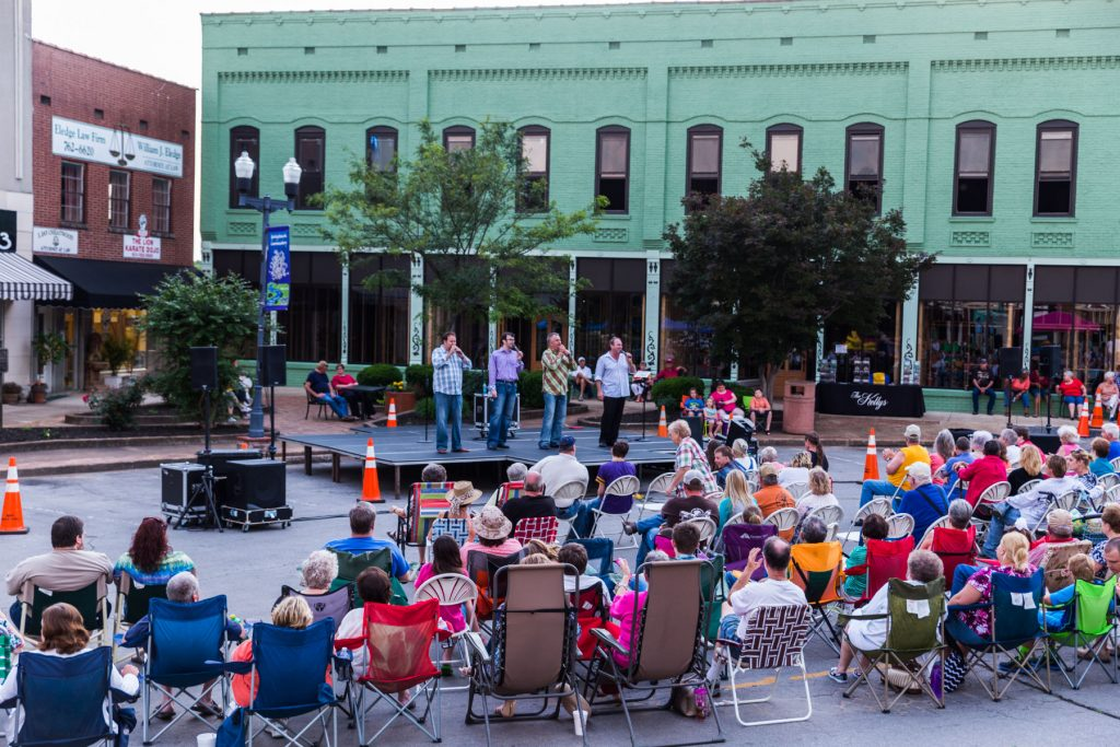 the kellys band singing on the square