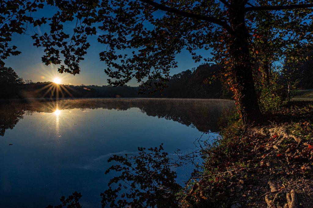 Sun coming up on lindsey lake.